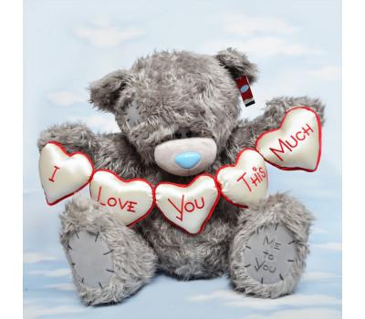 Большой Тедди с гирляндой сердец