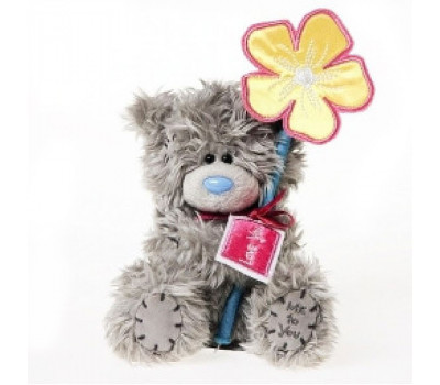 Медвежонок Тедди в коробочке и держит цветок