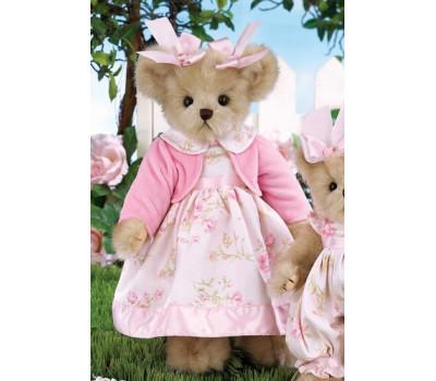 Мишка Беррингтон в платье, кофте и с бантами на голове