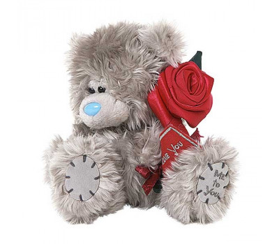 Мишка Тедди держит красную розочку
