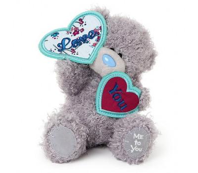 Мишка Тедди с сердечками в лапках